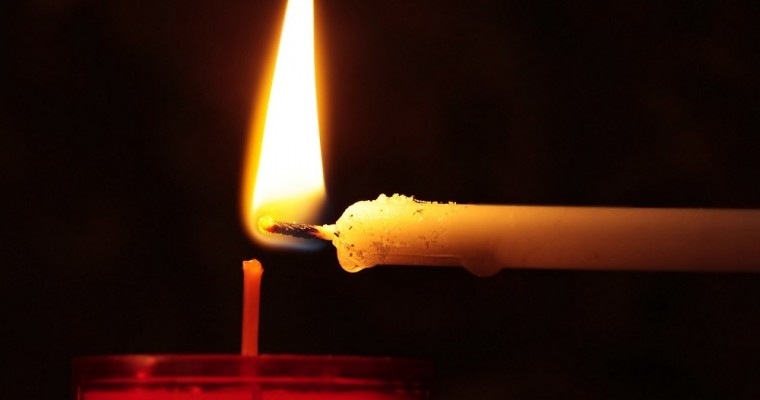 Why lighting up a candle in church?